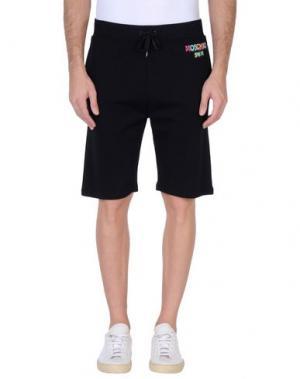 Пляжные брюки и шорты MOSCHINO. Цвет: черный