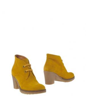 Полусапоги и высокие ботинки GIONATA. Цвет: охра