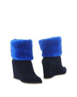 Полусапоги и высокие ботинки GIANMARCO LORENZI. Цвет: темно-синий