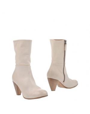 Полусапоги и высокие ботинки EL. Цвет: слоновая кость