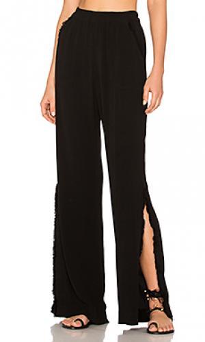 Расклешенные широкие брюки с разрезом Raquel Allegra. Цвет: черный