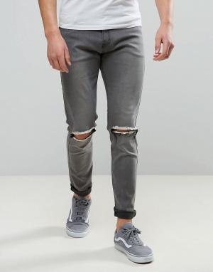 Liquor N Poker Серые узкие джинсы с рваными коленями. Цвет: серый