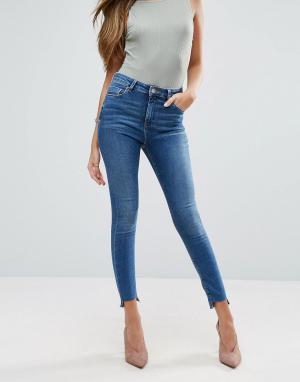 ASOS Выбеленные зауженные джинсы со ступенчатым краем RIDLEY. Цвет: синий