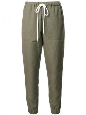 Зауженные брюки Bassike. Цвет: зелёный