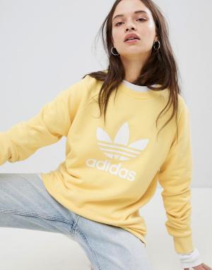 Adidas Originals Белый oversize-свитшот с логотипом-трилистником. Цвет: желтый