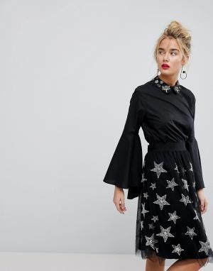 Essentiel Antwerp Блузка с расклешенными рукавами и отделкой. Цвет: черный