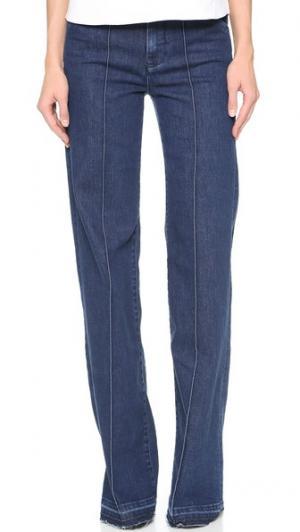 Широкие джинсы-скинни со складками Victoria Beckham. Цвет: индиго с потертым эффектом