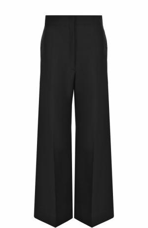 Шерстяные расклешенные брюки со стрелками Christophe Lemaire. Цвет: черный