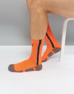 Puma Оранжевые спортивные носки Football evoTRG 65536306. Цвет: оранжевый