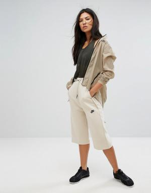 Nike Укороченные брюки. Цвет: кремовый