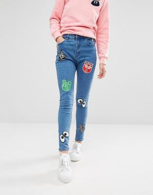 Mini Cream Зауженные джинсы с нашивками. Цвет: синий