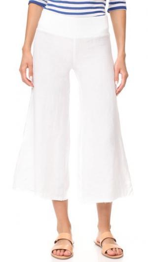Укороченные широкие льняные брюки Enza Costa. Цвет: белый