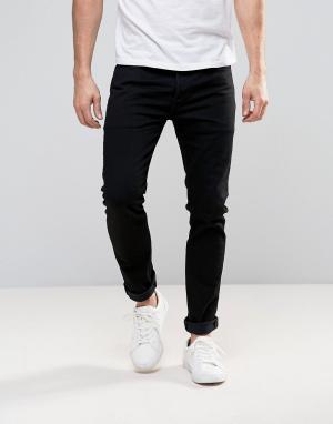 Levis Черные выбеленные джинсы скинни 501. Цвет: черный