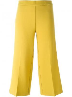 Укороченные расклешенные брюки P.A.R.O.S.H.. Цвет: жёлтый и оранжевый