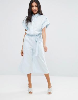 Liquorish Комбинезон с юбкой-шортами. Цвет: синий