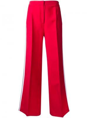 Расклешенные брюки с полосками по бокам Fendi. Цвет: красный