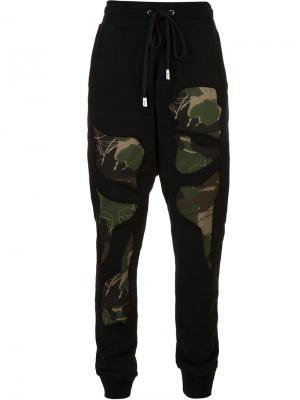 Спортивные брюки с камуфляжными деталями Haculla. Цвет: чёрный