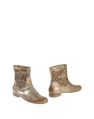 Полусапоги и высокие ботинки JOKER. Цвет: золотистый