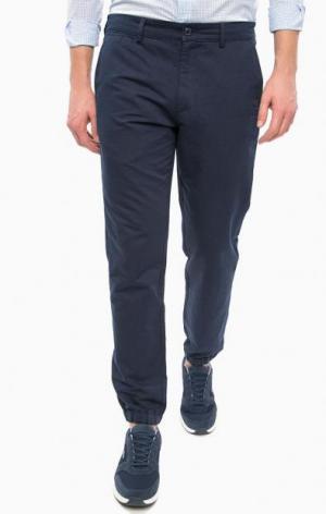 Синие брюки с манжетами Lacoste. Цвет: синий