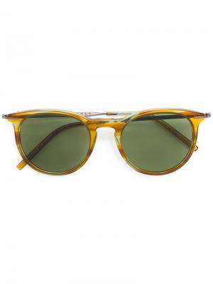 Солнцезащитные очки в круглой черепаховой оправе Tomas Maier Eyewear. Цвет: телесный
