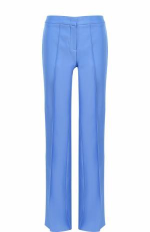 Расклешенные брюки с карманами и стрелками Emilio Pucci. Цвет: голубой