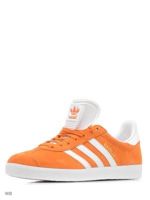 Кеды  GAZELLE UNIORA/WHITE/GOLDMT Adidas. Цвет: белый, оранжевый