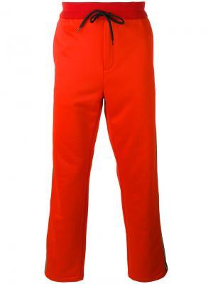 Спортивные брюки с лампасами Golden Goose Deluxe Brand. Цвет: красный