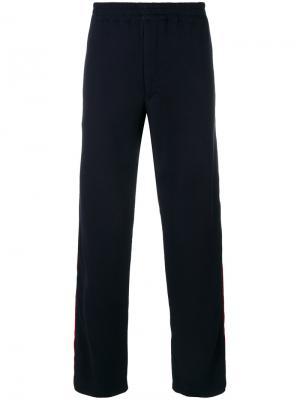 Спортивные брюки с лампасами Alexander McQueen. Цвет: синий