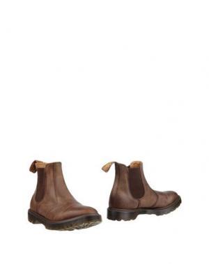 Полусапоги и высокие ботинки DR. MARTENS. Цвет: хаки