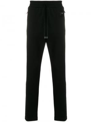Спортивные брюки узкого кроя с заплаткой логотипом Dolce & Gabbana. Цвет: чёрный