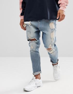 ASOS Выбеленные голубые рваные джинсы заниженного кроя. Цвет: синий