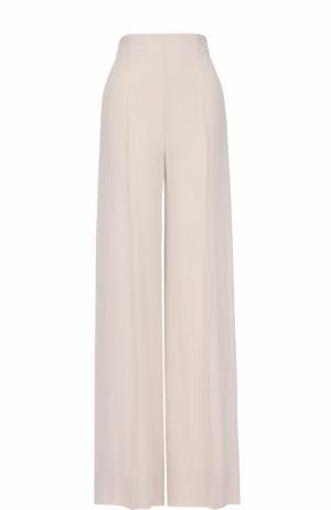 Однотонные расклешенные брюки со стрелками Roland Mouret. Цвет: кремовый