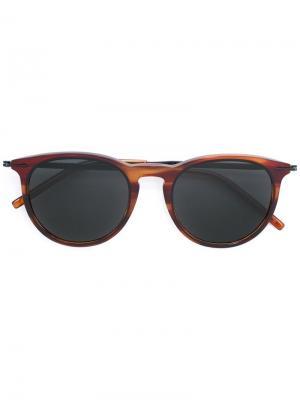 Солнцезащитные очки в круглой оправе Tomas Maier Eyewear. Цвет: коричневый