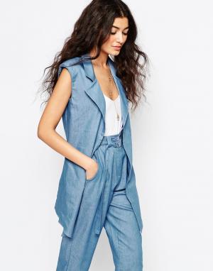 Never Fully Dressed Удлиненный блейзер без рукавов из ткани шамбре. Цвет: синий