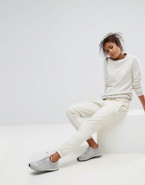 New Balance Трикотажные штаны кремового цвета. Цвет: кремовый