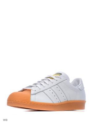 Кеды муж. SUPERSTAR 80s DLX  FTWWHT/FTWWHT/GOLDMT Adidas. Цвет: белый, оранжевый