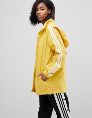 Adidas Originals Желтая спортивная куртка с капюшоном и тремя полосами. Цвет: желтый