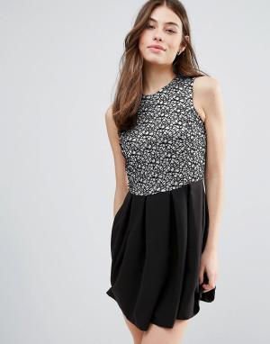 Hedonia Короткое приталенное платье с блестящей отделкой. Цвет: черный