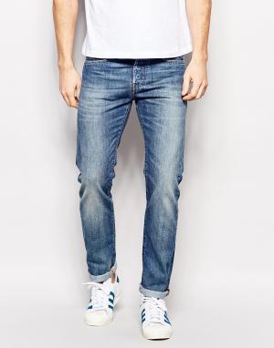 Edwin Суженные книзу джинсы слим Jeans ED-80. Цвет: синий