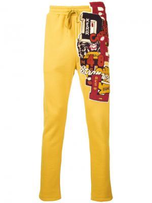 Спортивные брюки с вышивкой Doublet. Цвет: жёлтый и оранжевый