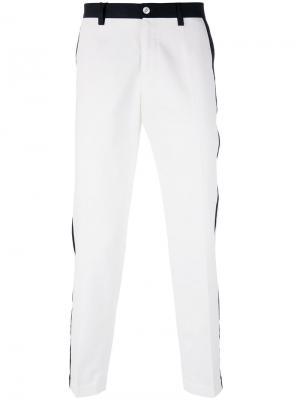 Брюки с контрастной окантовкой Dolce & Gabbana. Цвет: белый