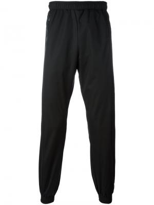 Спортивные брюки с эластичными щиколотками Cottweiler. Цвет: чёрный