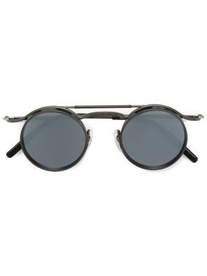 Солнцезащитные очки в круглой оправе Matsuda. Цвет: металлический