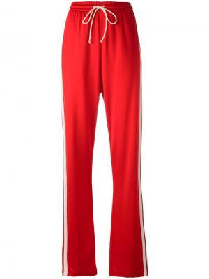 Спортивные брюки с лампасами Mm6 Maison Margiela. Цвет: красный