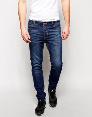ASOS Темные зауженные джинсы. Цвет: синий