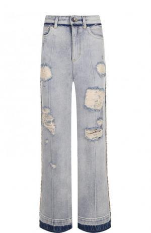 Укороченные расклешенные джинсы с потертостями Dolce & Gabbana. Цвет: голубой