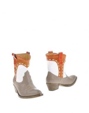 Полусапоги и высокие ботинки CHIARINI BOLOGNA. Цвет: серый