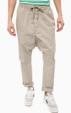 Хлопковые зауженные брюки на резинке ALCOTT. Цвет: серый
