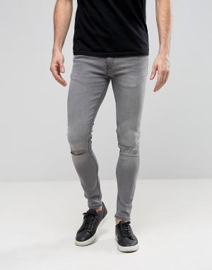Ringspun Супероблегающие джинсы с рваными коленями. Цвет: серый