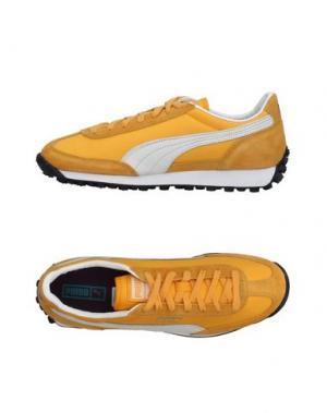 Низкие кеды и кроссовки PUMA. Цвет: желтый